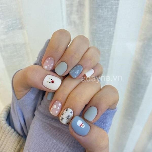 Mẫu móng tay đẹp nhẹ nhàng tone pastel xanh hồng trắng phù hợp diện vào ngày đông