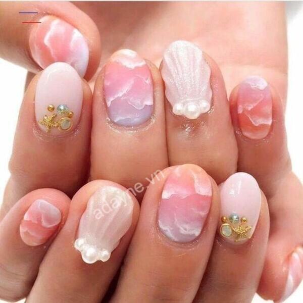 Theo đuổi phong cách nàng tiên cá xinh đẹp, ngọt ngào với mẫu nail xinh cute vỏ sò tông hồng gợi cảm